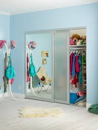 kids bedroom with mirrored closet combined with blue painted wall and white skin animal