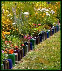 glass bottles border flower bed