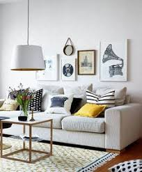 living room art work. [you can\u0027t have kids and a white couch, but otherwise, i dig.] cool vintage style prints (via planete deco) - my ideal home. living room art work