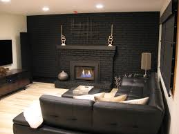i m going to paint our fireplace black too love this look
