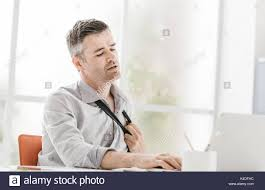 hot office pic. Nervous Businessman Working In A Very Hot Office, He Is Sweating And Loosening His Tie Office Pic