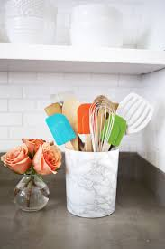 Recover your utensil holder with marble contact paper for a inexpensive  marble look