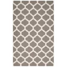 brown and white geometric rug