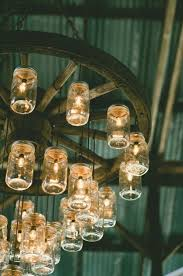 mason jar lighting ideas. would love to have this mason jarwagon wheel chandelier in a finished barn next project got 8 of wheels jar lighting ideas