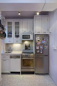 10 Tiny Kitchens In Tiny Houses That Are Adorably Functional Tiny House Kitchen House Design Kitchen Small Apartment Kitchen