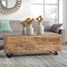 Surely, a coffee table with a storage shelf underneath its top is nothing unusual. Ovid Solid Wood Storage Lift Top Coffee Table Reviews Joss Main