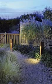 fabulous english cottage garden design with ambient led outdoor lighting ideas and wooden fences