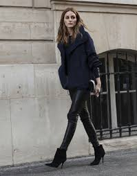 olivia palermo is wearing a navy blue jacket from akris and the black leather trousers and