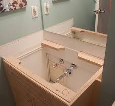 fort worth plumber installing a bathroom sink