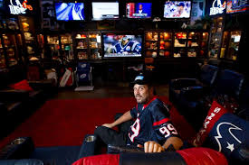 Sports man cave Amazing Blake Barnes Texans Fan Stands In His Man Cave That Can Seat About Loctek Deer Park Man Has The Best Man Cave Ever Houston Chronicle