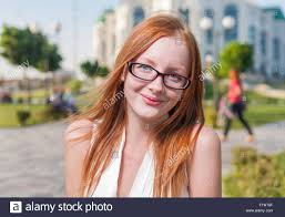 Mature redhead in glasses