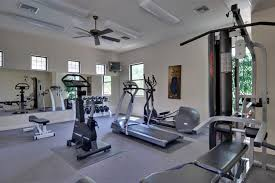 home gym lighting. ceiling lighting and fan with window treatments also gym equipments for home ideas a