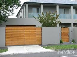 swinging garage doors house with swing gate timber look swinging garage door seal swinging garage doors