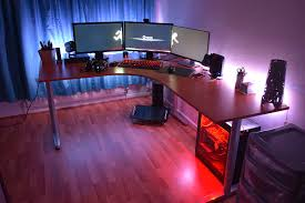 tidy battlestations with ikea bekant desk with triple monitors setup and red led light bekant desk sit stand screen