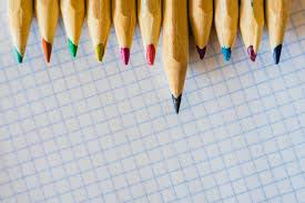 Group Of Pencils Arranged On Graph Paper Photo Premium