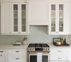 my client fell in love with the pale aqua glass moroccan esque backsplash tile it s a nice contrast to all the white
