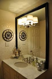 this bathroom mirror is only framed on 3 sides with the bottom edge resting on the