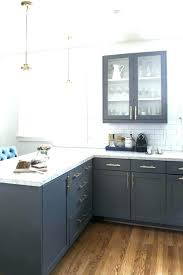 dark gray kitchen cabinets with white showy grey countertops granite tile