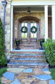 Double arched front doors, stone path, urn planters | DIY Ideas ...