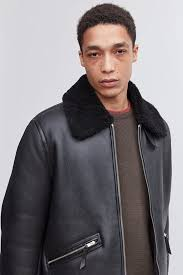 while very similar to the er in terms of looks the flight jacket carries the added bonus of a shearling collar that was originally designed to keep