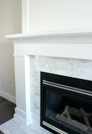 subway tile fireplaces white painted fireplace with marble subway tile the makeover details