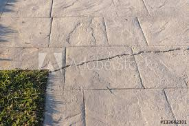 deep break on surfaces of stamped concrete pavement outdoor appearance colors and textures of paving slate stone tile on cement flooring exterior