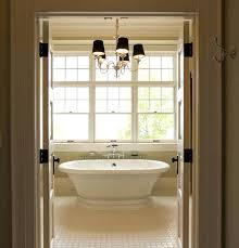 chandelier over tub master bathrooms with vessel sinks bathroom height
