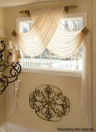 window scarf with sheer swag panels but look at the scroll design bet you could duplicate with to rolls