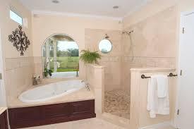 bathroom wall decorating ideas. Bathroom. White Bathtub On The Corner And Beige Tile Wall Connected By Black Metal Towel Bathroom Decorating Ideas I