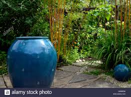 blue glazed urn planter feature pot pots garden design gardens gardening art installation centerpiece rm fl