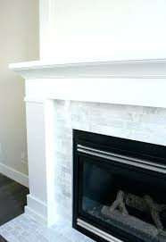 grey tile fireplace surround white painted fireplace with marble subway tile the makeover details tile fireplace glass tile fireplace