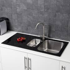 sauber 1 5 bowl kitchen sink with black glass surround and left hand drainer