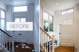 stepping inside the designers reinstated the stained glass in the fan light window above the front door and side window bringing light color