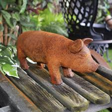 small rustic metal pig sculpture