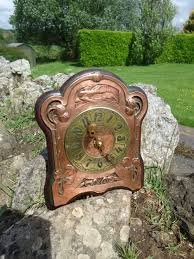 arts crafts copper wall clock with brass face