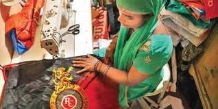 Discarded RCB flags get new lease of life as cloth bags- The New Indian  Express