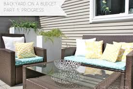 board batten wood siding with patio chair cushions