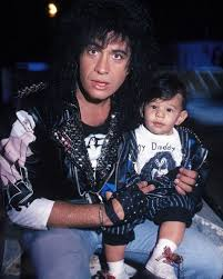 gene simmons son tongue. gene simmons with son nicholas - who is rocking a kiss t-shirt and leather tongue f