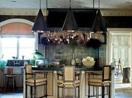 Kitchen With Green Tile Backsplash and Wine Racks