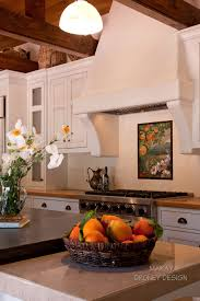 spanish tile backsplash kitchen eclectic with kohler cast iron