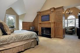 big master bedrooms couch bedroom fireplace: large master bedroom in luxury home with magnificent wooden fireplace dormer windows and separate