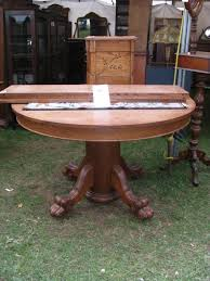 antique oak oval dining table. $1650.00; 48\ antique oak oval dining table