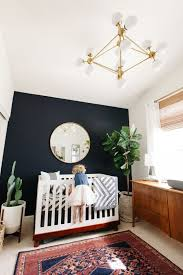 black accent wall in a kid s room for a mid century modern interior