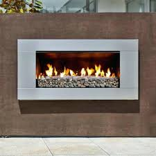 fire rocks for gas fireplace stainless steel with river rock lifestyle closeup fire rock gas fireplace