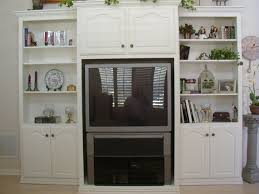 white custom wall unit with tv cabinet