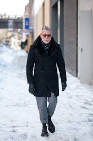 nick wooster wearing black fur collar coat grey wool dress pants black leather derby shoes navy and white polka dot scarf men s fashion