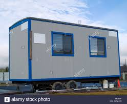 small portable office. A Small Portable Office On Wheels At Construction Site Warm Sunny Day - D