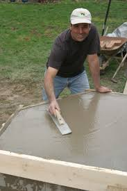 jeff wilson smoothing concrete for a diy brick bread oven