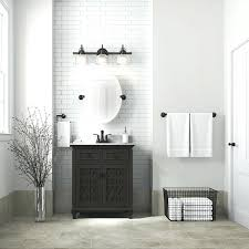 Powder Room Vanity Espresso With A White Subway Wall Tile An Oval  Mirror And Restoration Hardware Sink0
