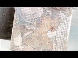 remove grout adhesive from tiles